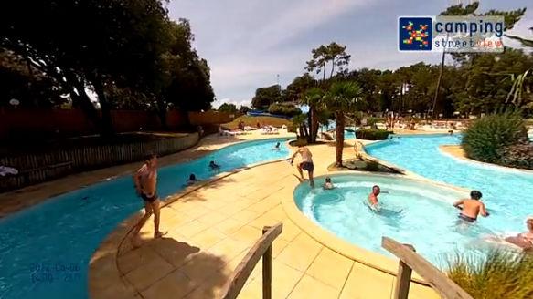Voir les vid os du yukadi village le logis for Camping st palais sur mer avec piscine